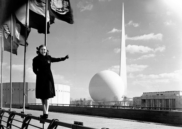 Rosalie Fairbanks, a guide to the New York World's Fair, points to the theme of the exposition -- the Trylon and Perisphere -- in New York on February 22, 1939, after the entire sheath of scaffolding was removed for the first time.