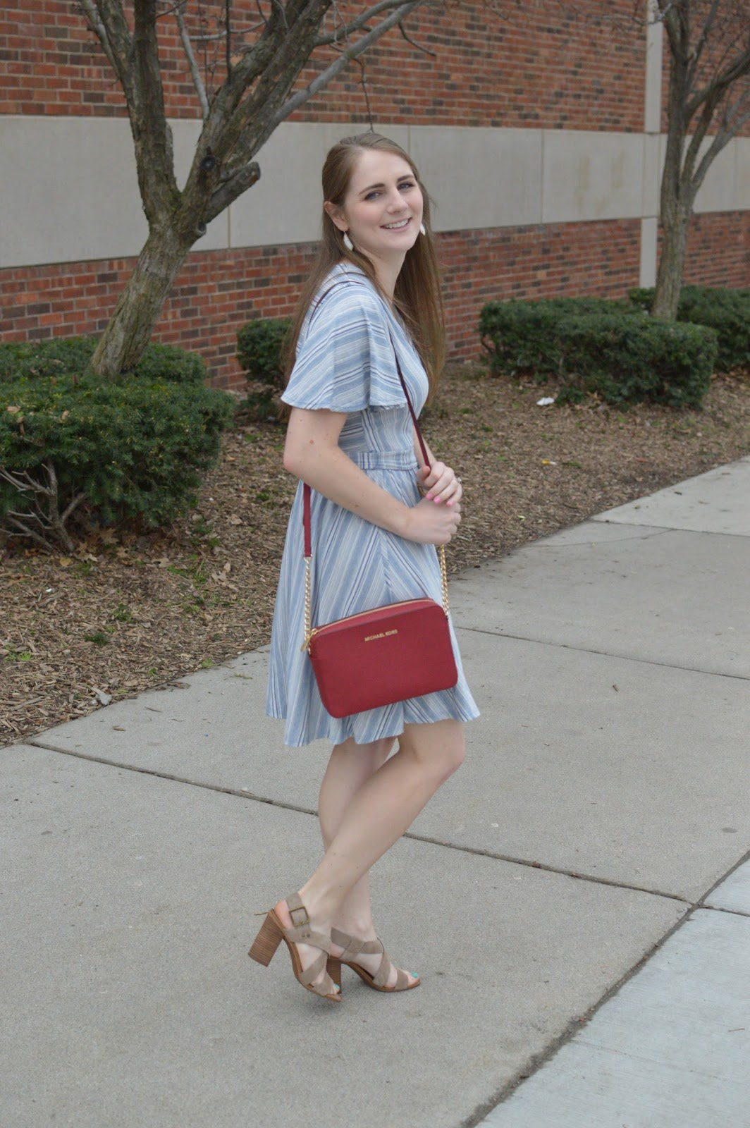 striped dress with a red bag: cute dresses for spring