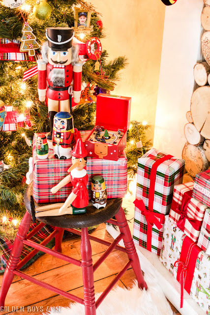 Christmas collectibles including German nutcracker, nesting dolls, music box and Pinnochio