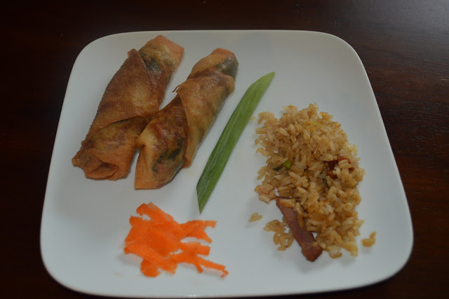 homemade spring rolls with fried rice, green onion, and carrots