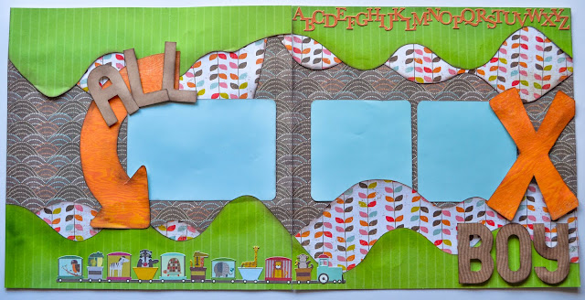 boy scrapbook page layout in orange, green, blue with hills and trains