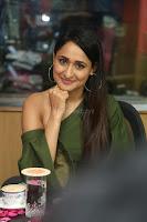 Pragya Jaiswal in a single Sleeves Off Shoulder Green Top Black Leggings promoting JJN Movie at Radio City 10.08.2017 036.JPG
