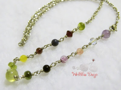 Wire wrapped necklace with Prehnite, Peridot, Garnet, faceted and round Amethyst, Swarovski Crystal, Agate and Tourmaline