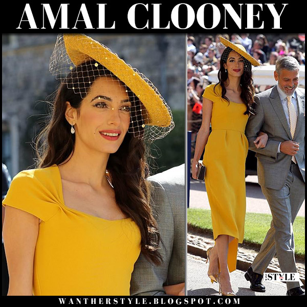 Amal Clooney in yellow midi dress stella mccartney and hat at Prince Harry and Meghan Markle's wedding royal fashion