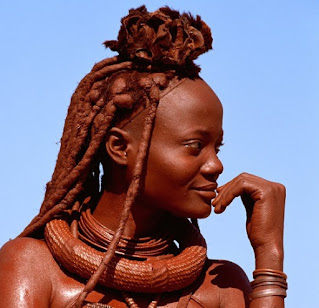 A young Himba woman wearing her erembe headdress of a married woman. Photo Copyright Carol Beckwith & Angela Fisher 1994 from the collection of African Ceremonies.