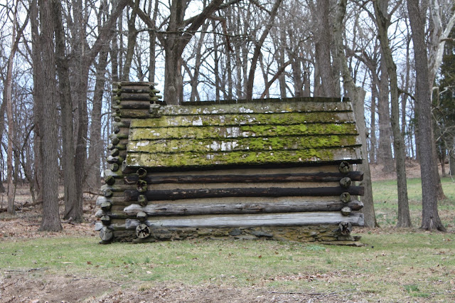 Log hut at Valley Forge covered with moss