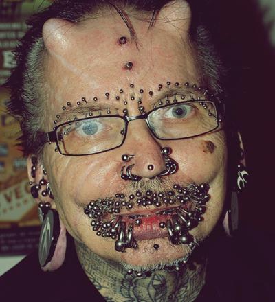 Rolf Buchholz, o homem com mais piercings no mundo - Sorriso na Web