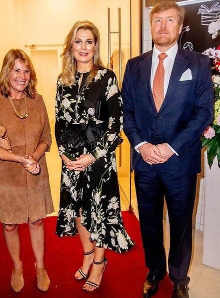 Queen Maxima wore a floral print silk dress by Johanna Ortiz, and she wore Gianvito Rossi sandals, diamond earrings