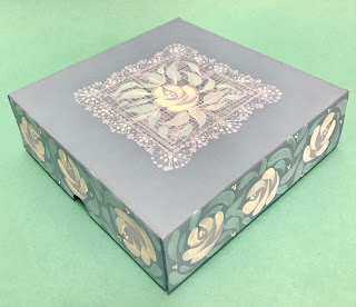 Pairing vintage roses and delicate lace from You Can Folk It's folk art painting kits to decorate this gift box.