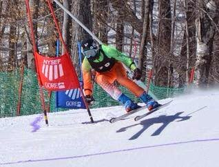 Skier in orange and green Artica Speed Suit