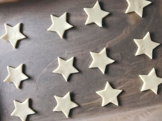 Pastry cut out into stars and laid on a baking tray