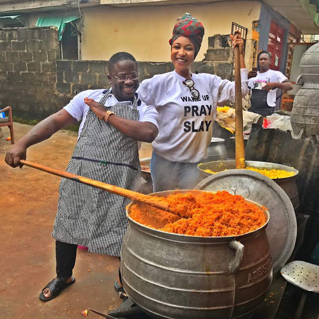 Tonto Dikeh cooks massive pots of rice for Charity
