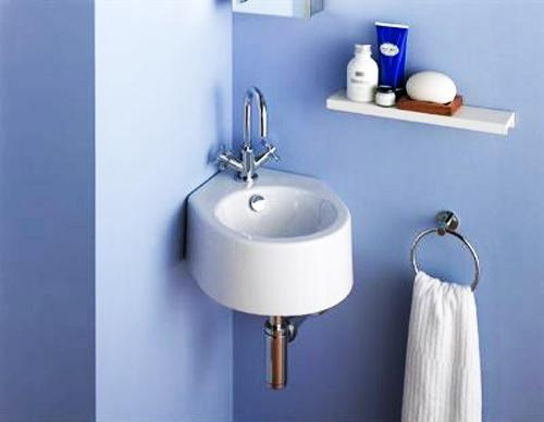 round shaped wall mounted corner sink for bathroom blue wall paint small towel holder