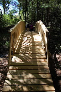 arched foot bridge at Dacey Field disc golf course