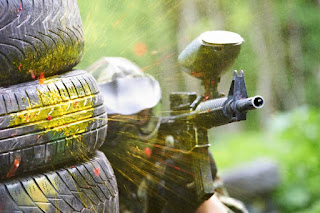 Paintball player getting shot at