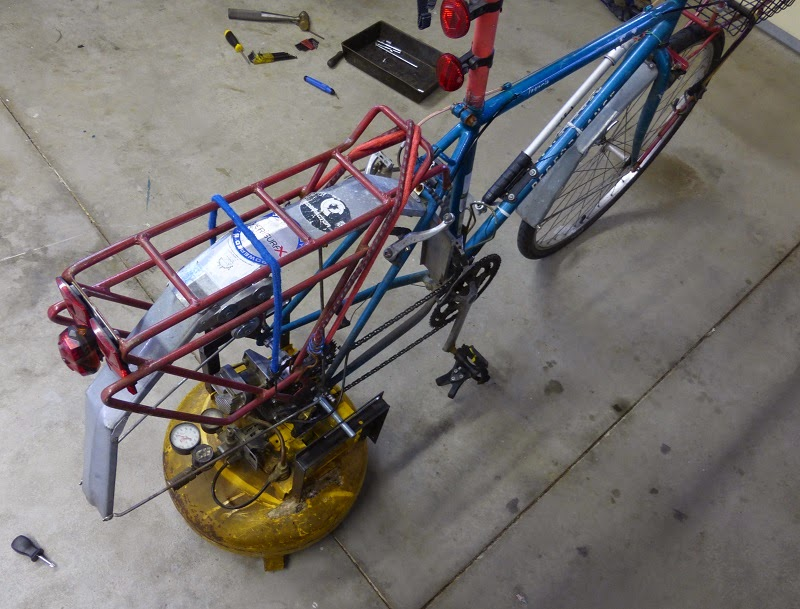 bicycle mounted on air compressor top view