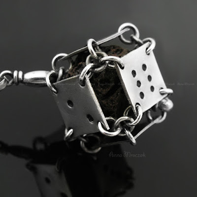 https://www.etsy.com/listing/106035800/volcanic-lava-in-sterling-dice-pure?ref=shop_home_active_13