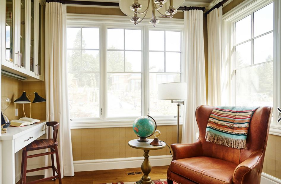 In The Room Below Dark Leather Chair Gets A Fresh Light Look With White Linen Drapes And Bright Paint On Trim Moldings Built Desk