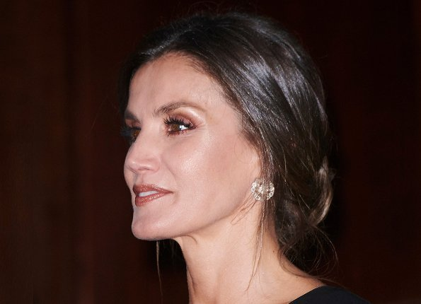 Queen Letizia wore Emporio Armani Ruffle Side Dress, diamond earrings. Concert held at Prince Felipe Auditorium in Oviedo
