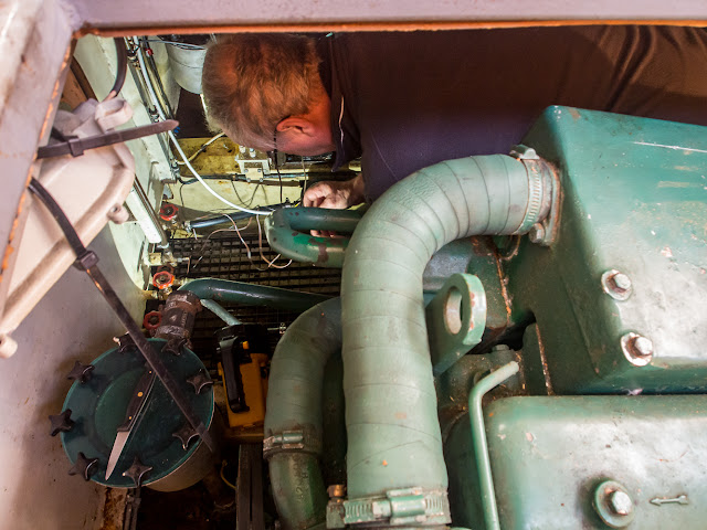 Photo of Phil preparing the wiring for the new bilge pump in the engine room