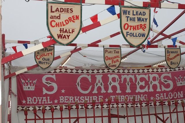 Signage and artwork of the Carters Steam Fair coconut sheet game.
