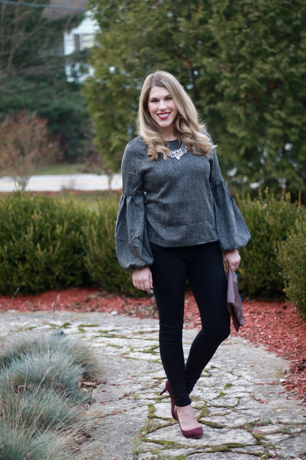 casual holiday outfit, shein grey lantern sleeve top, old navy black jeans, burgundy suede heels, burgundy fold over clutch