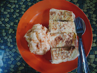 Nicely cut and stacked up roti telur bawang
