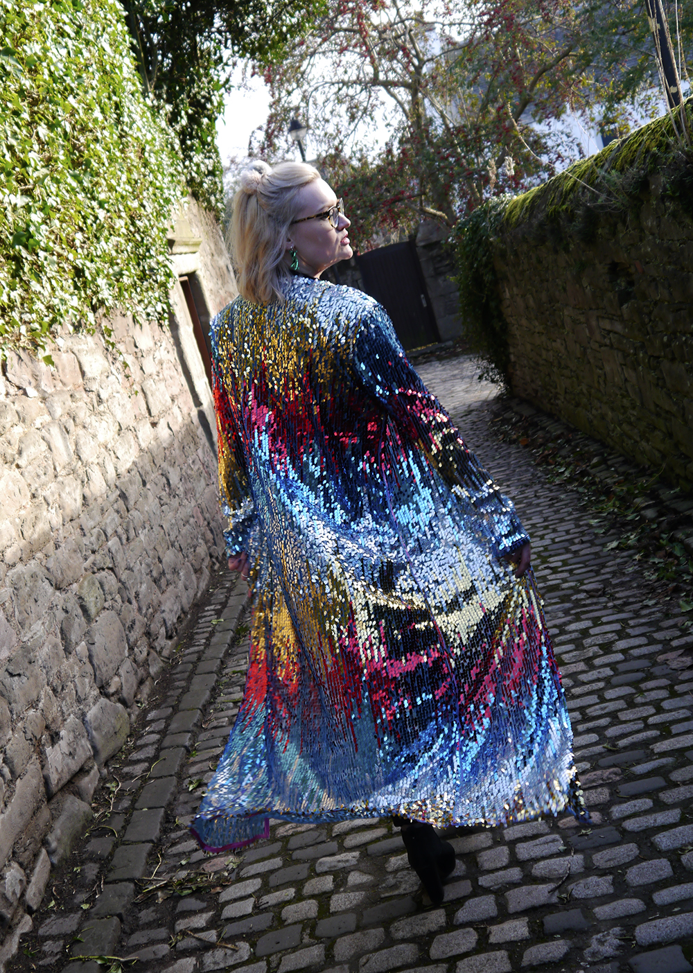 Street style with full length sequin rainbow jacket by isolated heroes
