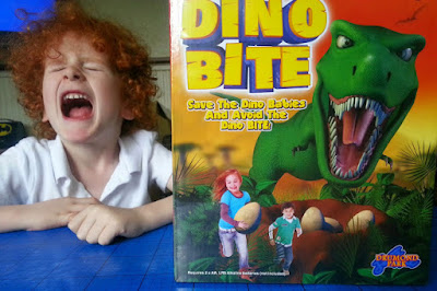 Dino Bite game box and dinosaur roar