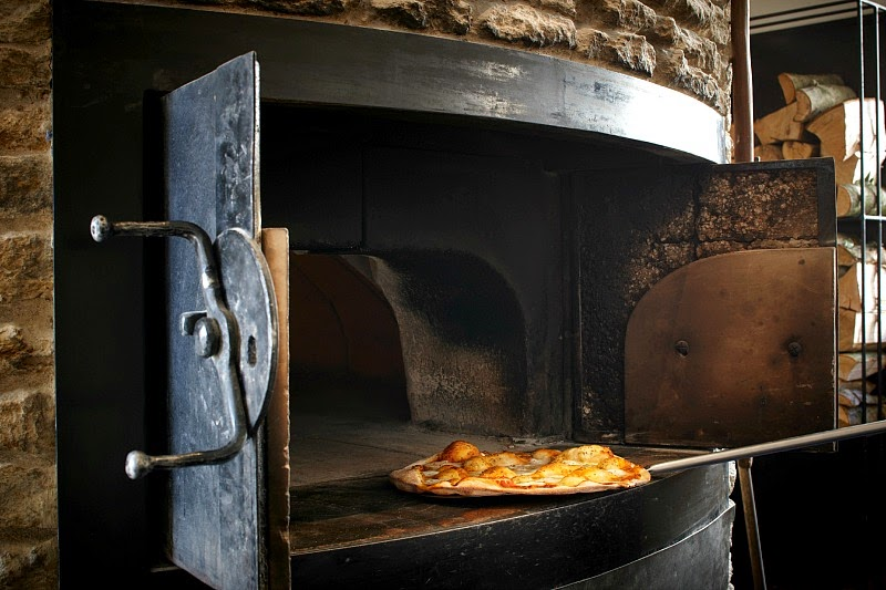 delicious pizza from a stone pizza oven