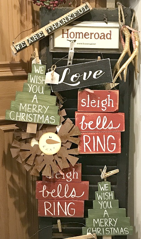 Rustic holiday signs and shutter display