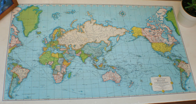 A close up of the map top wood desk