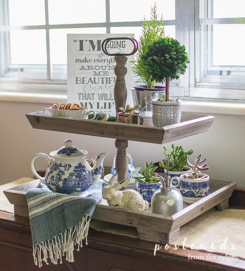 wood tiered tray with blue and white accents