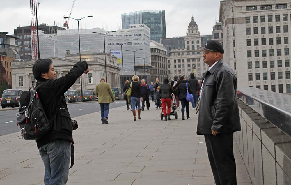 photographing a tourist
