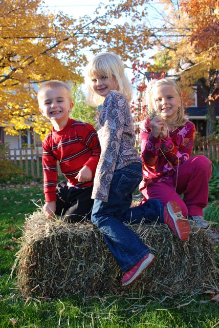 Fall kid photos with a hay bale