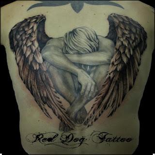 под крылом ангела тату надпись