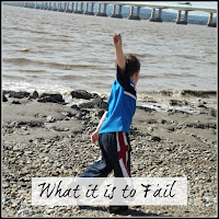`Boy throwing stones into the river Severn