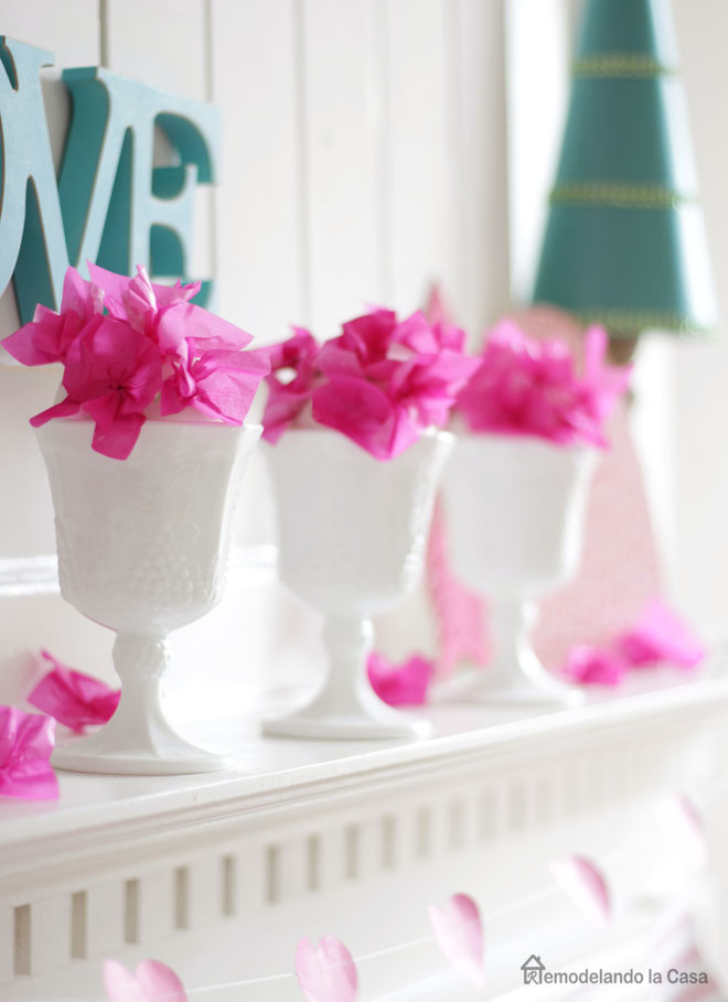 Milk glass water goblets as paper tissue flower vases