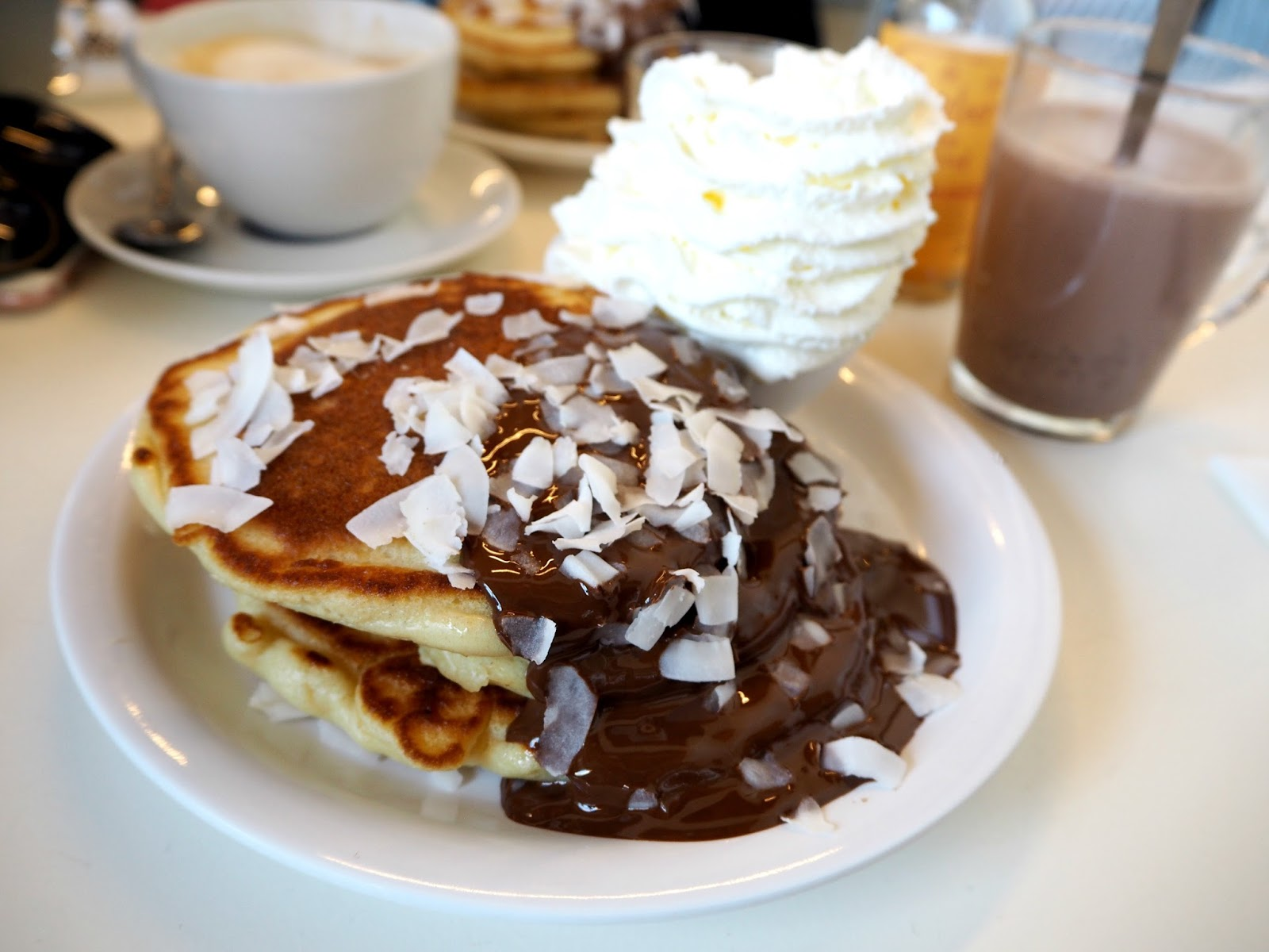 Pancakes Amsterdam chocolate with coconut flakes