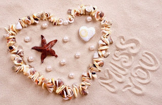 miss you pic with heart created on beach sand