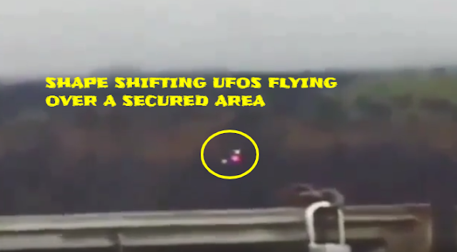 Three UFOs flying in formation over a secured area and turn in to one UFO.