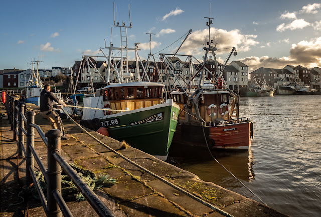 Photo of fishing boats in Maryport Harbour at high tide