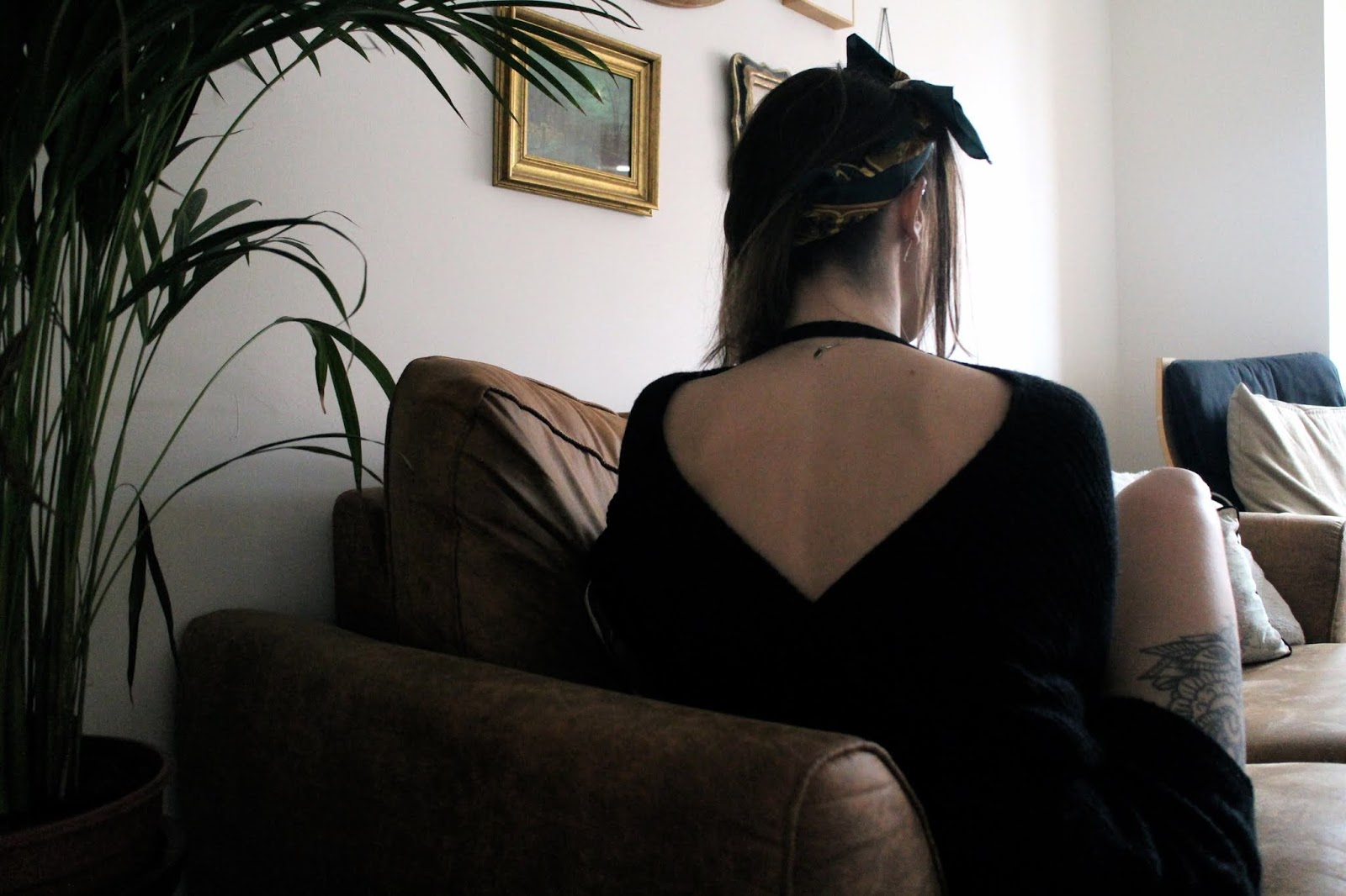 Low back of black knitted jumper dress