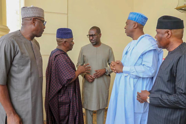 Saraki with other senators speaking with son of Late Chief Tony Anenih