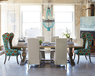 Fabulous Blue Chandelier in Dining Room with Comfortable Upholstered Dining Chairs and a Long Brown Table