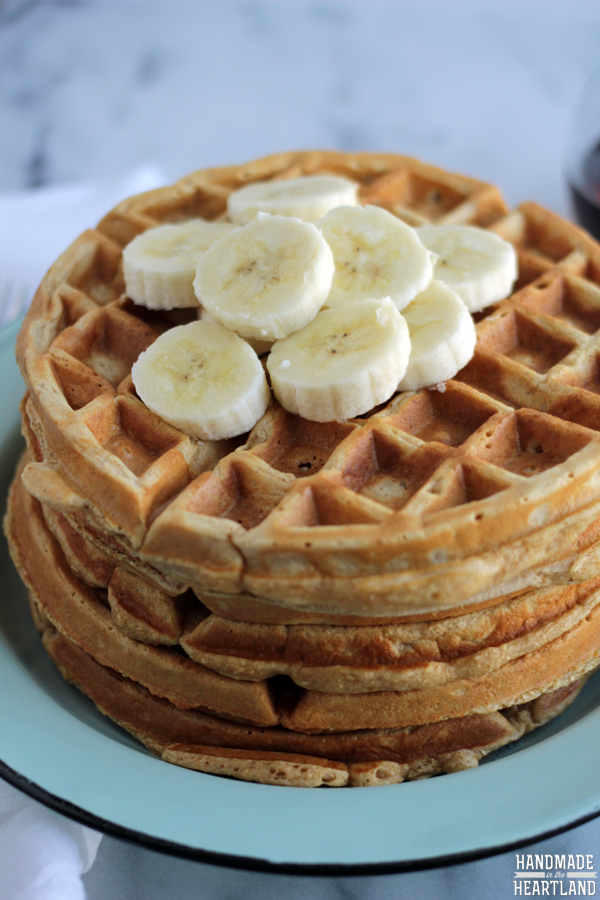 Healthy Whole Wheat Waffles stacked and topped with bananas