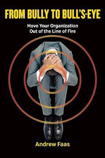 Book cover, 'From Bully to Bull's Eye: Move Your Organization Out of the Line of Fire' by Andrew Faas. Image depicts a seated man, his head pressed between his knees and his hands grasping the top of his head, with concentric-circle bull's-eye outlines superimposed on top of him
