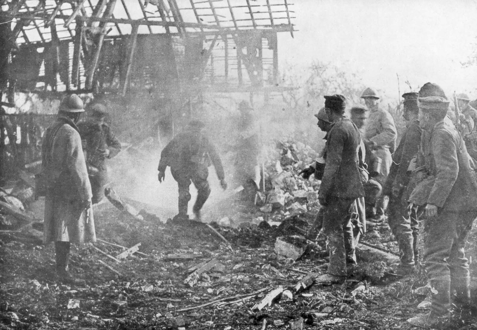 French troops use flamethrowers to flush out German positions in the town of Cantigny, France. 1918.