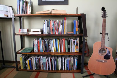 one of several rapidly filling bookcases