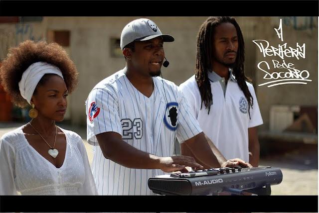 Casal formado por afro-americano e afro brasileira lançam vídeo clipe nas favelas de São Paulo